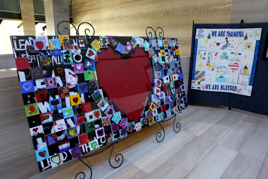 An art piece, left, created through a partnership with Gracieճ House and New Vista Art Project is on exhibit on the second floor of Las Vegas City Hall as part of the Hearts for Vegas projec ...