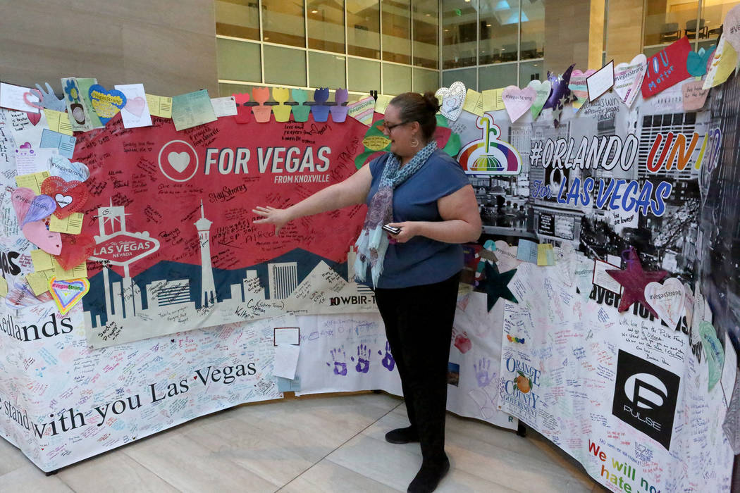 Ally Haynes-Hamblen, Cultural Affairs Director for the City of Las Vegas, points out some of the comments on the Hearts for Vegas display on exhibit on the second floor of Las Vegas City Hall as p ...
