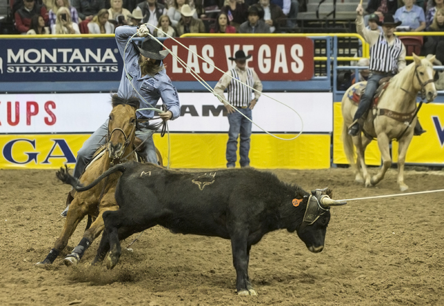 Canadian Jeremy Buhler zeros in on the heeling side during the sixth go-round of team roping in last year's Wrangler National Finals Rodeo, at the end of which Buhler and partner Levi Simpson fini ...