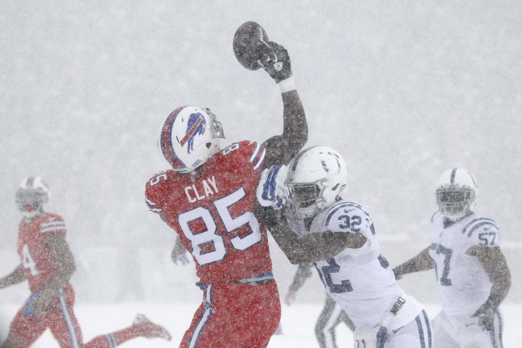 Buffalo Bills' Charles Clay, left, tries to make a catch over Indianapolis Colts' T.J. Green during the first half of an NFL football game, Sunday, Dec. 10, 2017, in Orchard Park, N.Y. (AP Photo/J ...