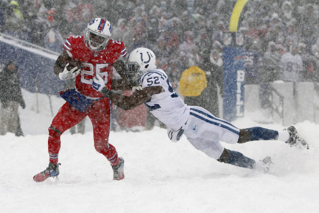 Indianapolis Colts outside linebacker Barkevious Mingo, right, tries to tackle Buffalo Bills running back LeSean McCoy during the second half of an NFL football game, Sunday, Dec. 10, 2017, in Orc ...