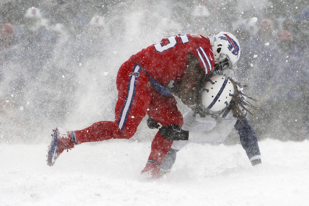 Buffalo Bills fullback Mike Tolbert, left, tries to run through Indianapolis Colts strong safety Matthias Farley during the second half of an NFL football game, Sunday, Dec. 10, 2017, in Orchard P ...