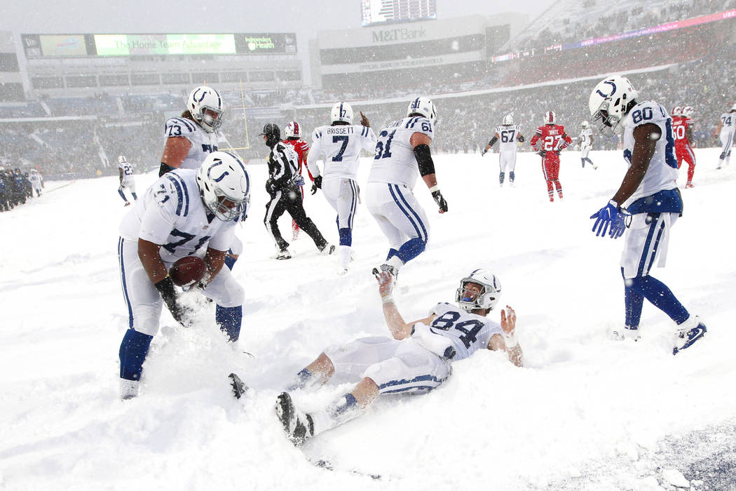 Indianapolis Colts tight end Jack Doyle, center, celebrates in the end zone during the second half of an NFL football game against the Buffalo Bills, Sunday, Dec. 10, 2017, in Orchard Park, N.Y. ( ...
