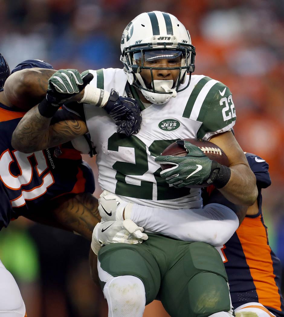 New York Jets running back Matt Forte (22) is hit by Denver Broncos inside linebacker Todd Davis (51) during the second half of an NFL football game, Sunday, Dec. 10, 2017, in Denver. (AP Photo/Jo ...