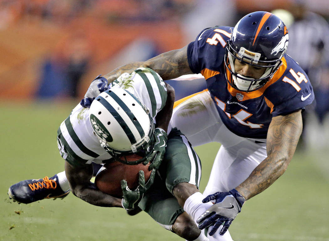 New York Jets tight end JoJo Natson (87) is hit by Cody Latimer (14) during the second half of an NFL football game, Sunday, Dec. 10, 2017, in Denver. (AP Photo/Jack Dempsey)