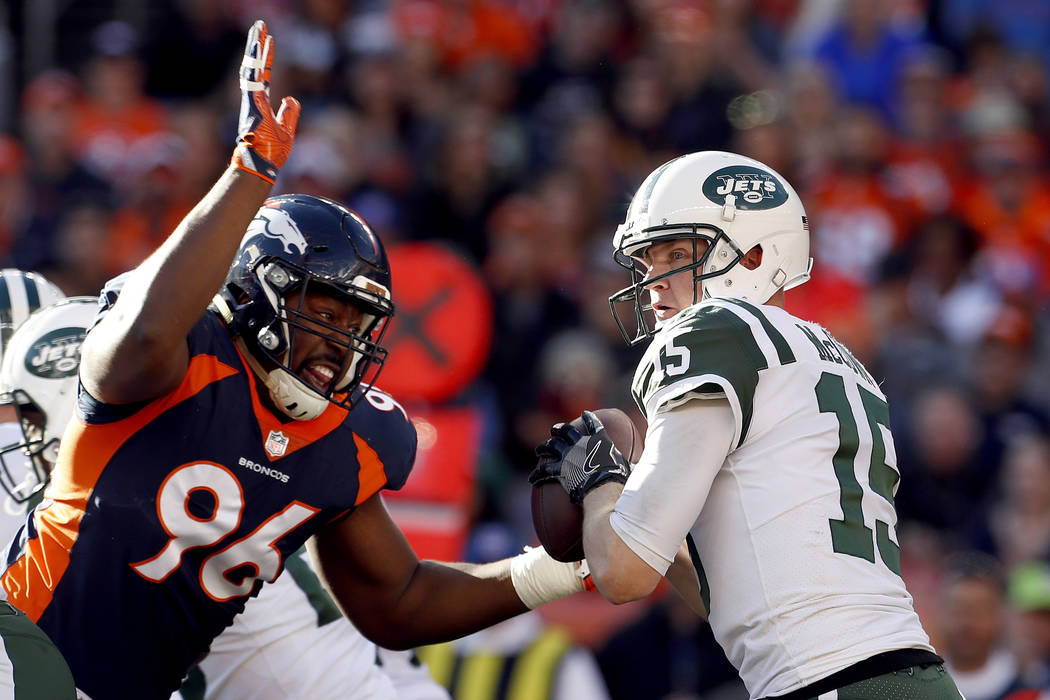 New York Jets quarterback Josh McCown (15) is sacked by Denver Broncos defensive end Shelby Harris (96) during the first half of an NFL football game, Sunday, Dec. 10, 2017, in Denver. (AP Photo/J ...