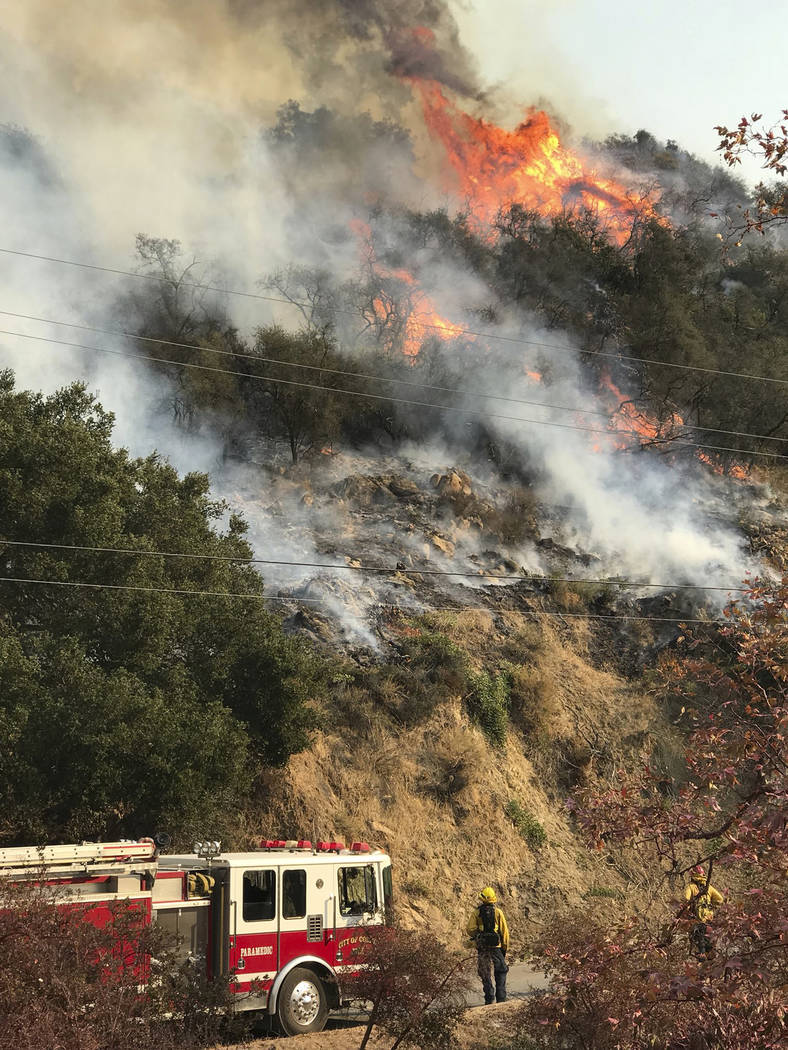 An engine company from the city of Colton, Calif., operating under mutual aid, keeps watch on pockets of burning and unburned vegetation off Bella Vista Dr. in Montecito, Calif., Wednesday, Dec. 1 ...