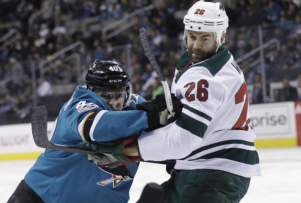 San Jose Sharks' Ryan Carpenter, left, collides with Minnesota Wild's Daniel Winnik (26)  during the second period of an NHL hockey game Sunday, Dec. 10, 2017, in San Jose, Calif. (AP Photo/Marcio ...