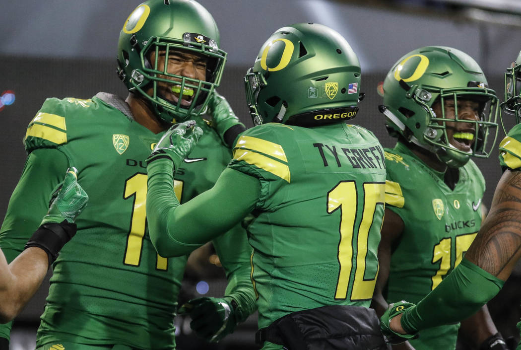 Oregon linebacker Justin Hollins (11), celebrates his interception for a touchdown in the second half against Oregon State in an NCAA college football game Saturday, Nov. 25, 2017 in Eugene, Ore.  ...