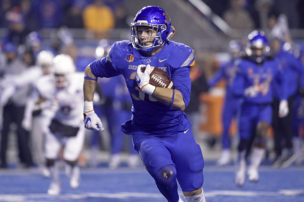 Boise State linebacker Leighton Vander Esch returns the ball after an interception in the closing minutes of an NCAA college football game against Fresno State for the Mountain West Conference cha ...