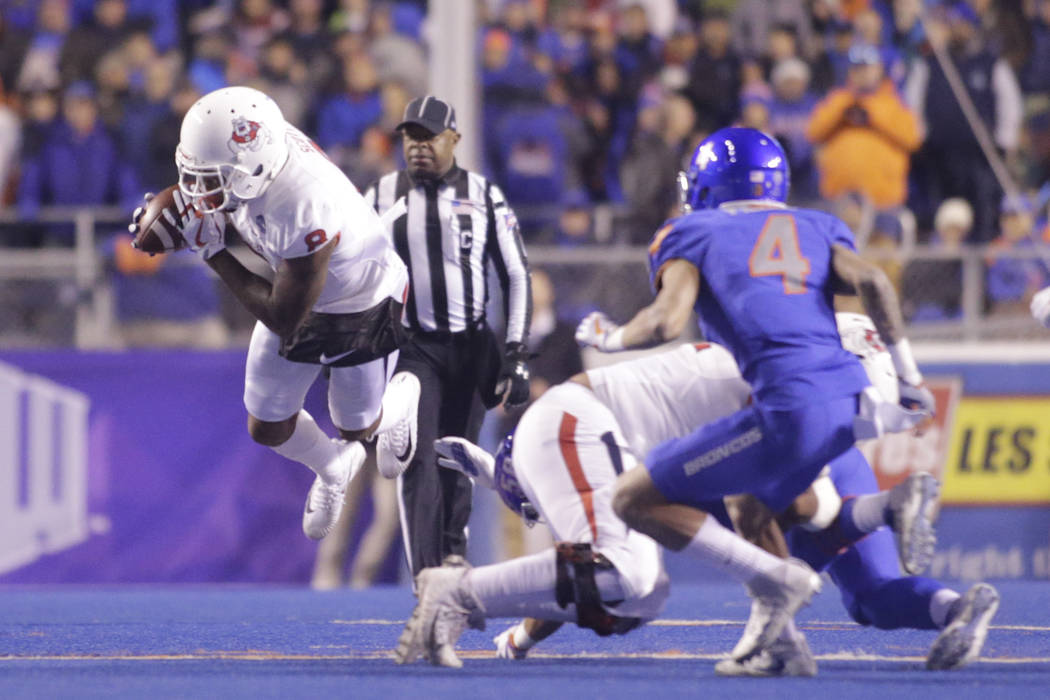 Fresno State wide receiver Da'Mari Scott (8) goes airborne during the first half of an NCAA college football game against Boise State for the Mountain West championship in Boise, Idaho, Saturday,  ...
