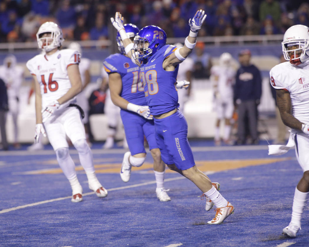 Boise State safety Kekaula Kaniho (28) reacts after a play during the second half of an NCAA college football game against Fresno State for the Mountain West championship in Boise, Idaho, Saturday ...