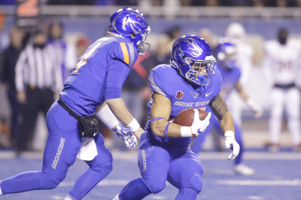 Boise State running back Ryan Wolpin runs the ball during the first half of an NCAA college football game against Fresno State for the Mountain West championship in Boise, Idaho, Saturday, Dec. 2, ...