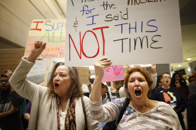 Deb Lomando, from left, and Donna West chant at a protest against President Trump's recent immigration executive order on Sunday, Jan. 29, 2017, at Terminal three at the McCarran International Air ...