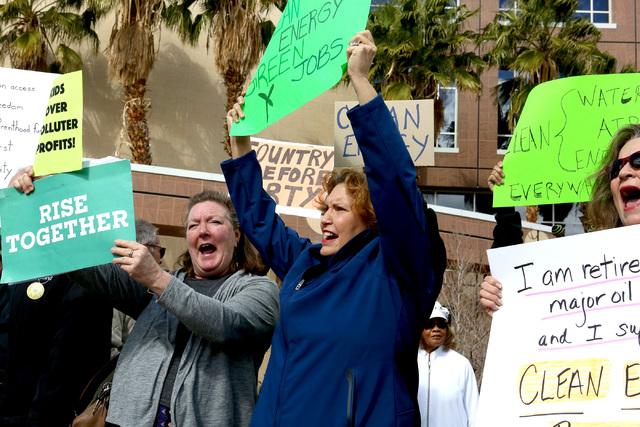 Kathy Lauckner, left, Donna West and Deb Lomando chant at a RenewNV rally for clean energy for Nevada in front of the Sawyer Building in Las Vegas on Monday, February 20, 2017. (Michael Quine/Las  ...