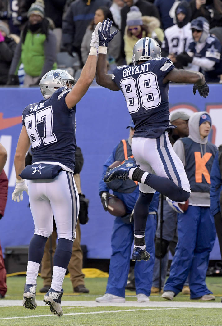 Dallas Cowboys tight end Geoff Swaim (87) celebrates with Dallas Cowboys wide receiver Dez Bryant (88) after scoring a touchdown against the New York Giants during the fourth quarter of an NFL foo ...