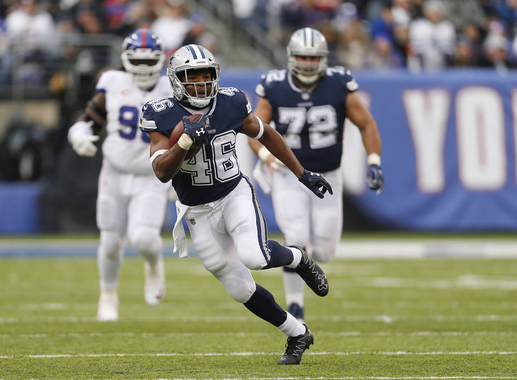 Dallas Cowboys running back Alfred Morris (46) runs the ball against the New York Giants during the third quarter of an NFL football game, Sunday, Dec. 10, 2017, in East Rutherford, N.J. (AP Photo ...