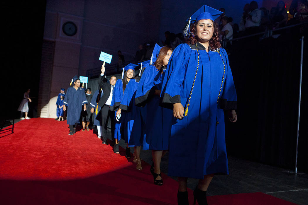 Desert Pines High School graduates walk towards their seats during the Clark County School District's fifth annual summer graduation ceremony on Tuesday, Aug. 23, 2016, at the Orleans Arena in Las ...