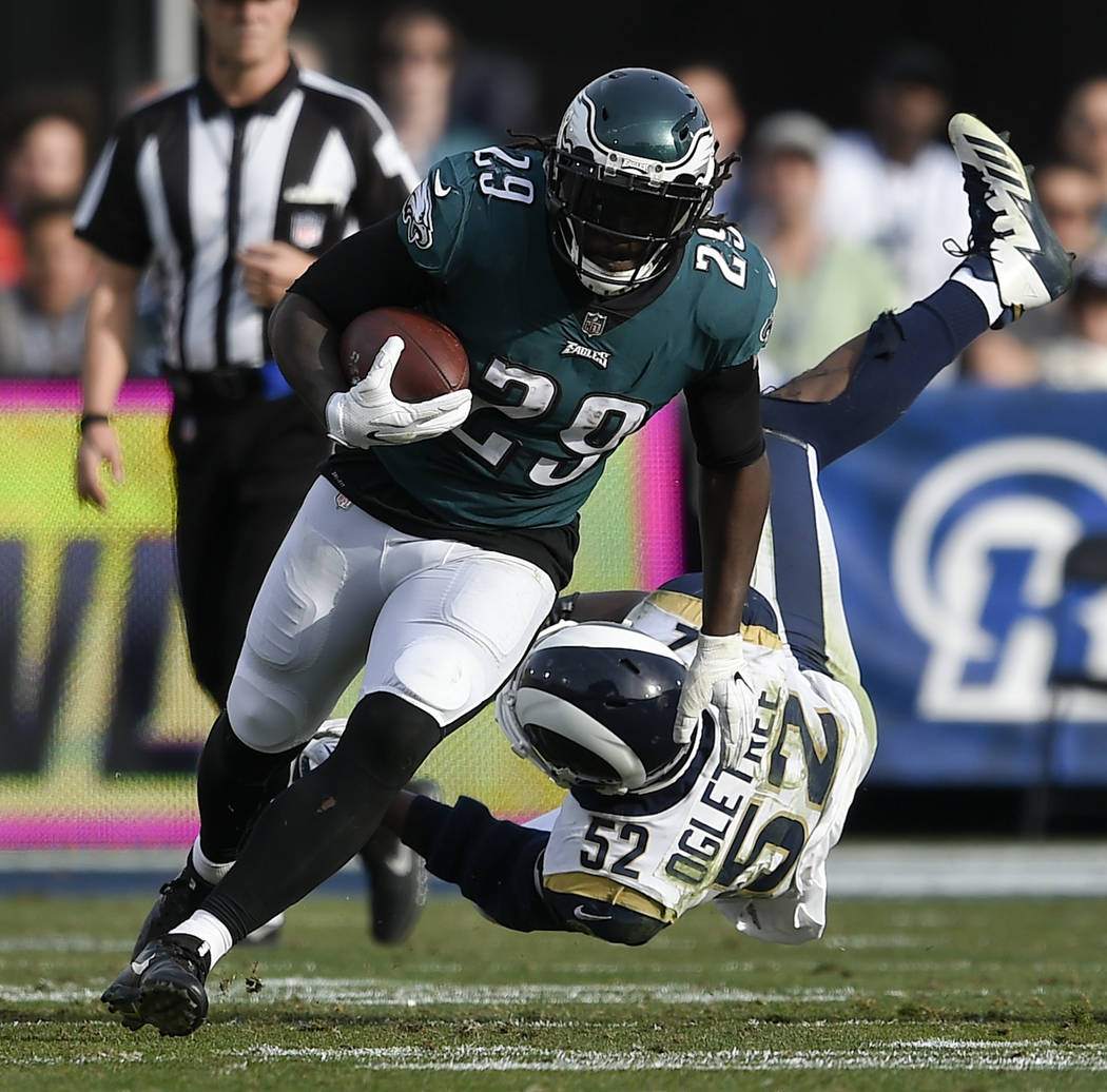 Philadelphia Eagles running back LeGarrette Blount runs past Los Angeles Rams inside linebacker Alec Ogletree during the first half of an NFL football game Sunday, Dec. 10, 2017, in Los Angeles. ( ...
