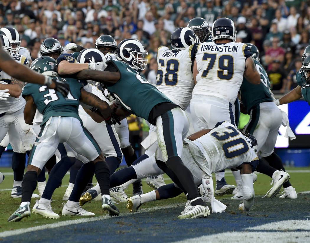 Los Angeles Rams running back Todd Gurley scores against the Philadelphia Eagles during the second half of an NFL football game Sunday, Dec. 10, 2017, in Los Angeles. (AP Photo/Mark J. Terrill)