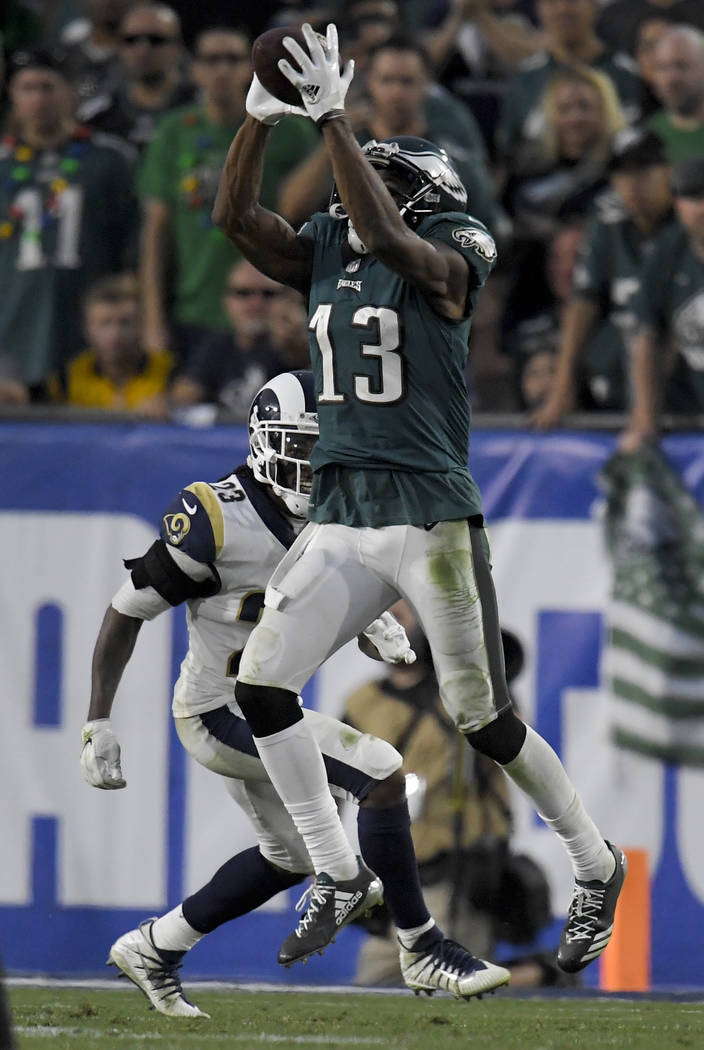 Philadelphia Eagles wide receiver Nelson Agholor catches a pass as Los Angeles Rams cornerback Nickell Robey-Coleman looks on during the second half of an NFL football game Sunday, Dec. 10, 2017,  ...