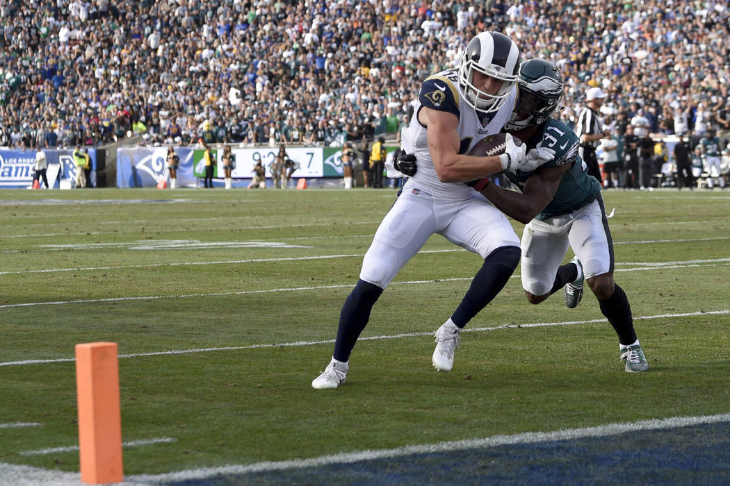 Los Angeles Rams wide receiver Cooper Kupp scores ahead of Philadelphia Eagles cornerback Jalen Mills during the first half of an NFL football game Sunday, Dec. 10, 2017, in Los Angeles. (AP Photo ...
