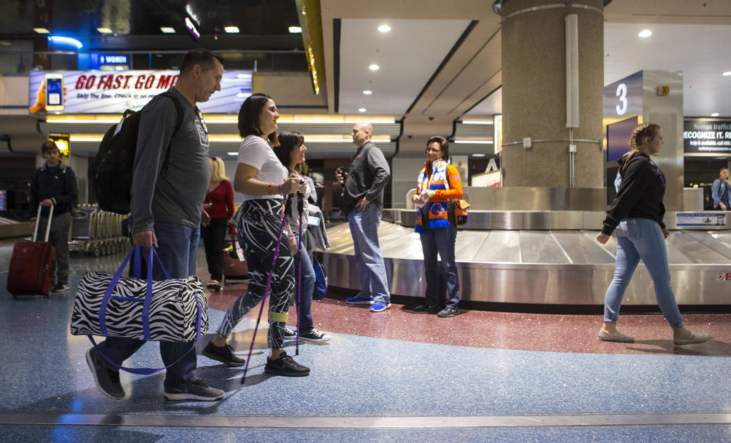 Nineteen-year-old Rylie Golgart, second from left, arrives at McCarran International Airport with her parents Richard Golgart, left, and Rose Fuscaldo in Las Vegas on Friday, Dec. 15, 2017. Golgar ...