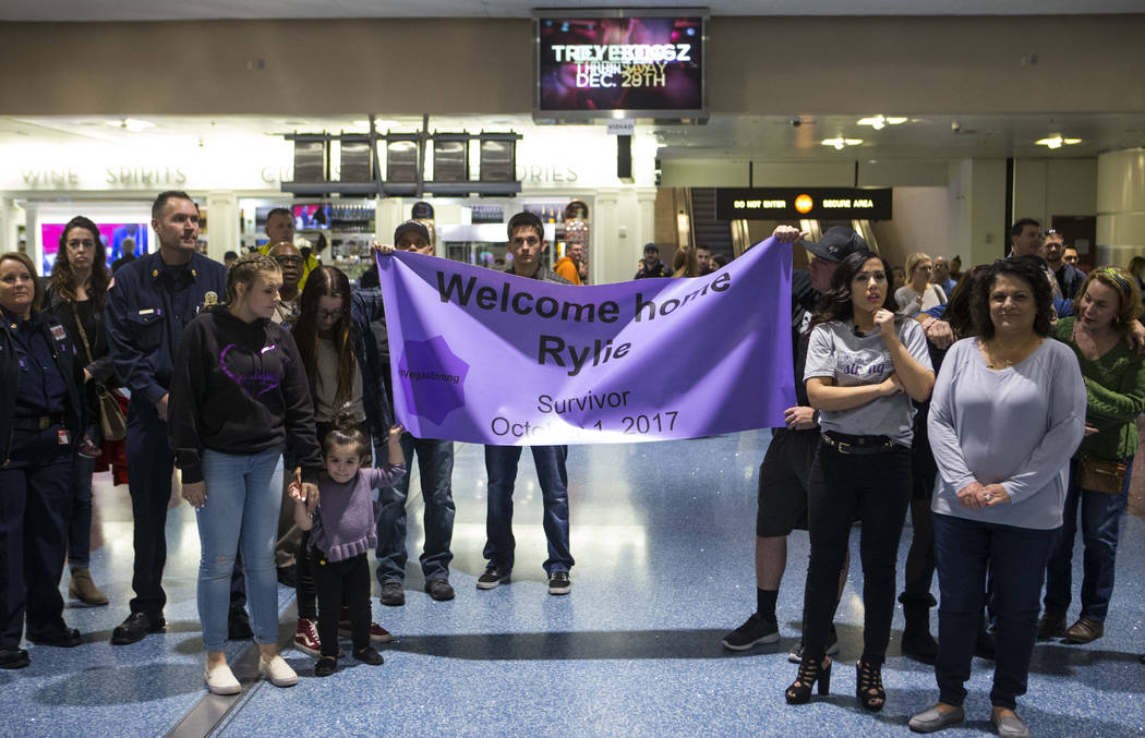 Friends and family members wait for the arrival of Rylie Golgart, 19, at McCarran International Airport in Las Vegas on Friday, Dec. 15, 2017. Golgart, a victim in the Oct. 1 shooting, spent two m ...