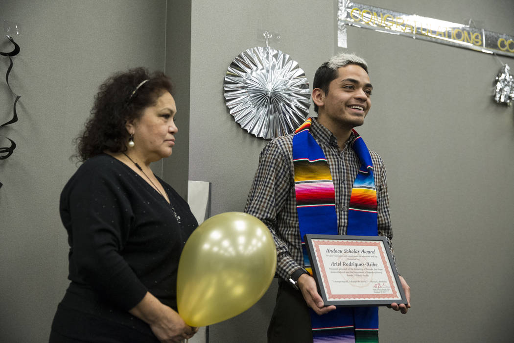 UNLV journalism graduate Ariel Rodriguez, right, with his aunt Isabel after getting recognized during a ceremony celebrating undocumented graduates at UNLV in Las Vegas, Saturday, Dec. 16, 2017. E ...