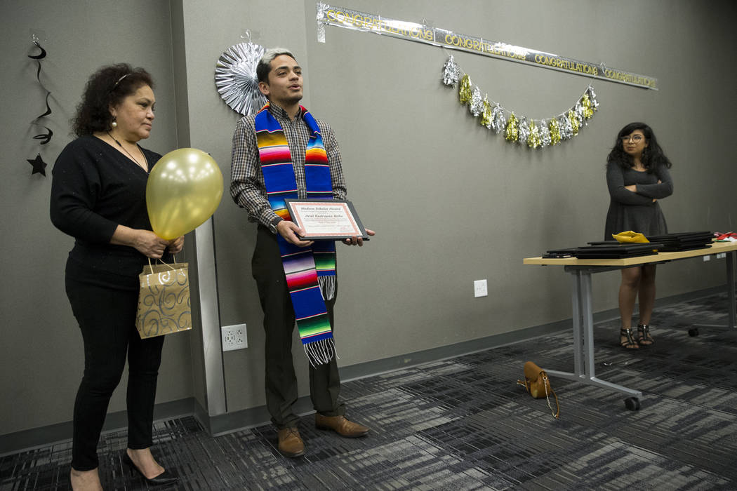 UNLV journalism graduate Ariel Rodriguez, center, with his aunt Isabel, left, gives a speech after getting recognized during a ceremony celebrating undocumented graduates at UNLV in Las Vegas, Sat ...