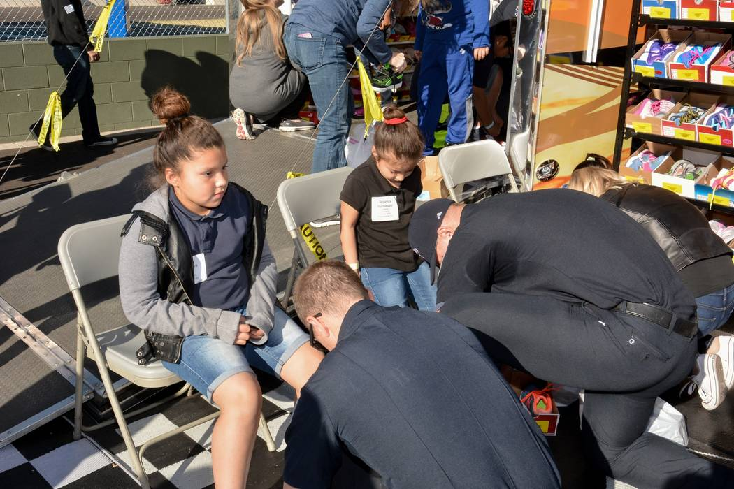 The Raiders teamed up with Goodie Two Shoes Foundation to give away 400 Pairs of shoes to Las Vegas children on Dec. 8, 2017. (Raiders)