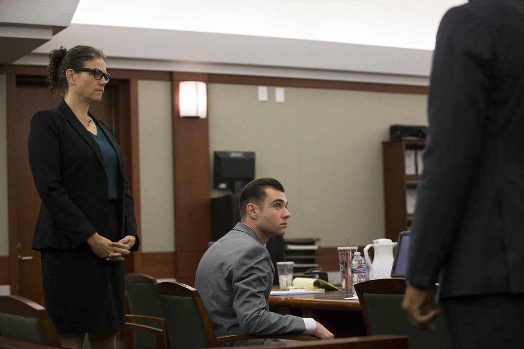 Defense attorney Monique McNeill, left, with her client Joshua Honea, a former Las Vegas police Explorer accused of a years-long sexual relationship with a teen, starting when she was 12, during h ...