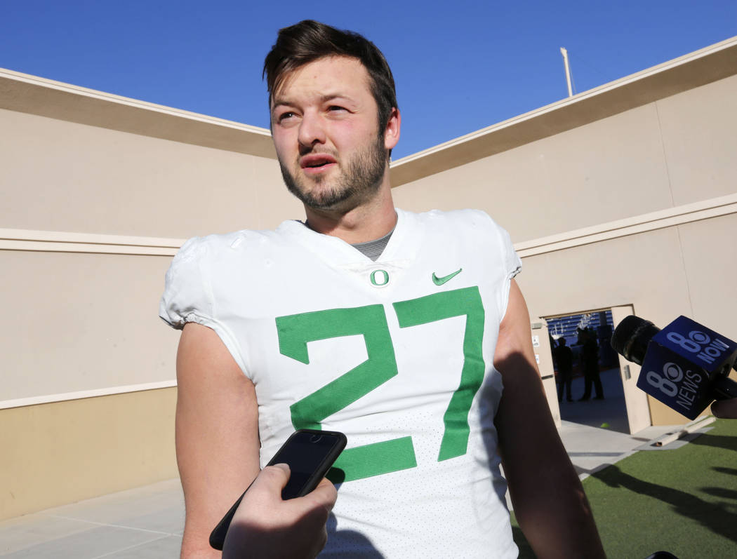 Oregon Ducks tight end Jacob Breeland (27) speaks to reporter before a football practice at Bishop Gorman High School in Las Vegas, Wednesday, Dec. 13, 2017. Oregon Ducks and Boise State Broncos w ...