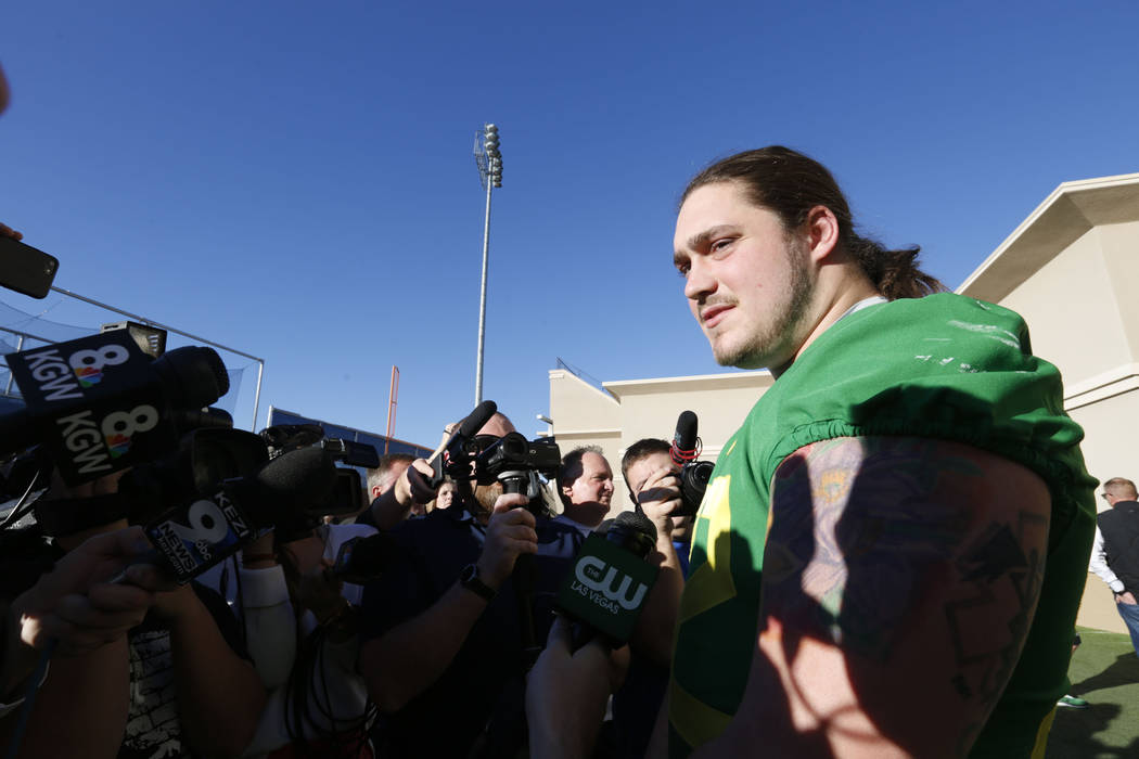 Oregon Ducks defensive lineman Henry Mondeaux speaks to reporters before a football practice at Bishop Gorman High School in Las Vegas, Thursday, Dec. 14, 2017. Oregon Ducks will meet Boise State  ...