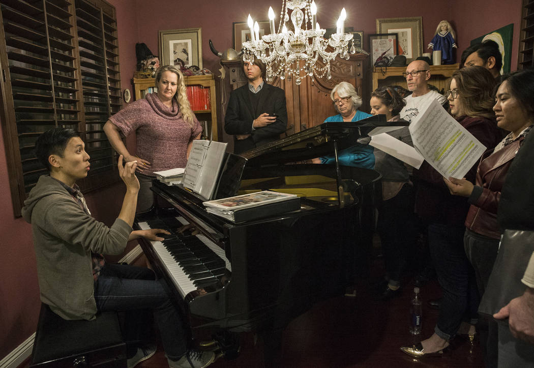 """Music director Dean Balan, left, gives notes during rehearsal for the Sin City Opera's upcoming concert """"Christmas at the Opera"""" on Monday, Dec. 11, 2017, in Las Vegas. Benjamin  ..."""