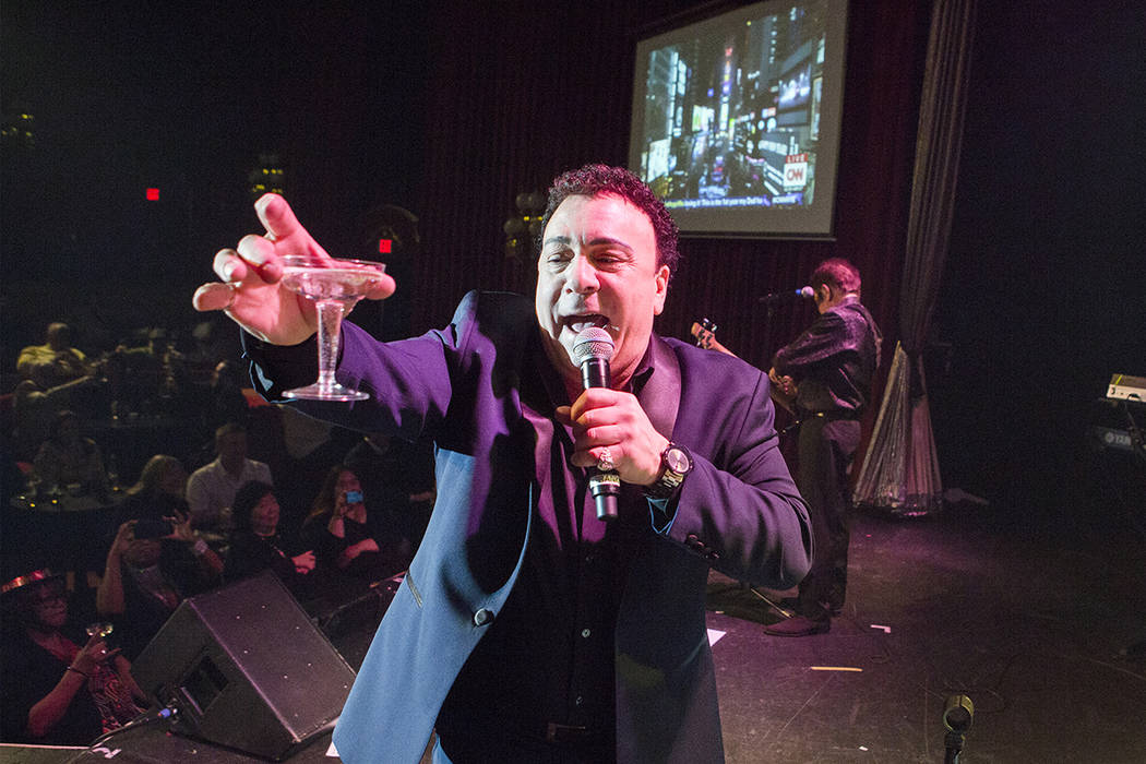 Frankie Scinta with the Scintas makes a New Year's toast on stage during their show at the Plaza hotel/casino on Saturday, Dec. 31, 2016. Jeff Scheid/Las Vegas Review-Journal Follow @jeffscheid