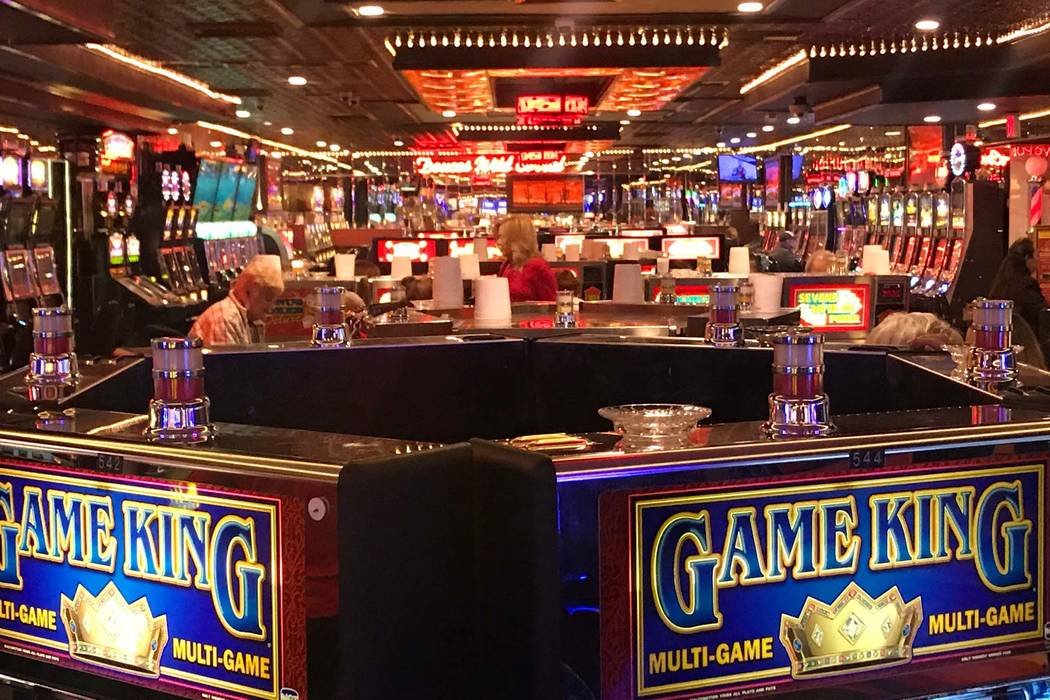 Plastic cups sit atop video poker games and other slots at Skyline Casino to collect quarters on Dec. 13, 2017. (Todd Prince/Las Vegas Review Journal)