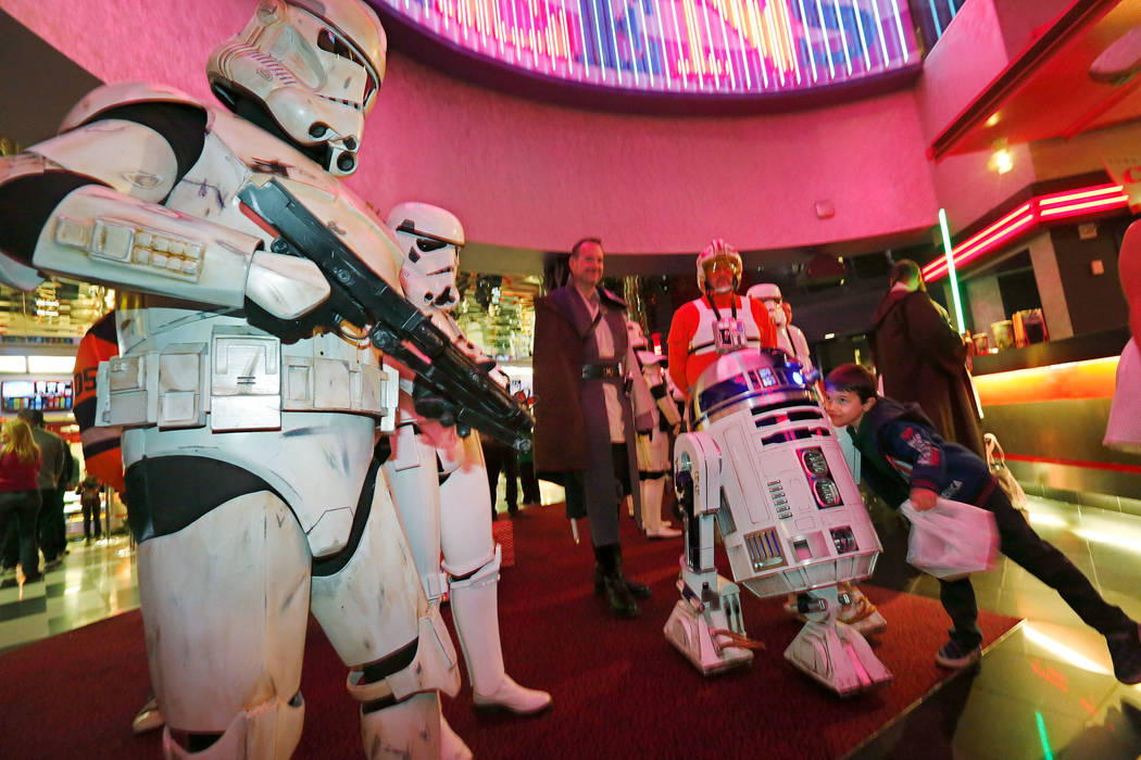 Philip Farino, 6, of Las Vegas, right, greets R2-D2 during the opening night fan event of Star Wars: The Last Jedi at Brenden Theatres at the Palms in Las Vegas, Thursday, Dec. 14, 2017, as Stormt ...