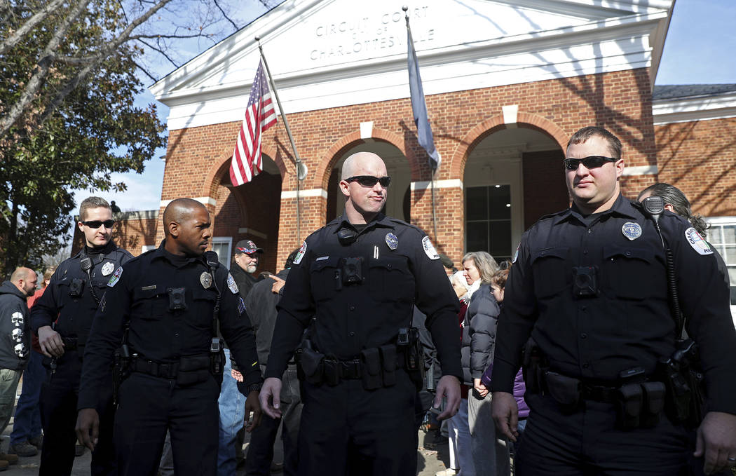 Police officers block the front of the Charlottesville Circuit Court building ahead of the preliminary hearing for James Fields on Thursday on Thursday, Dec. 14, 2017 in Charlottesville, Va. Field ...