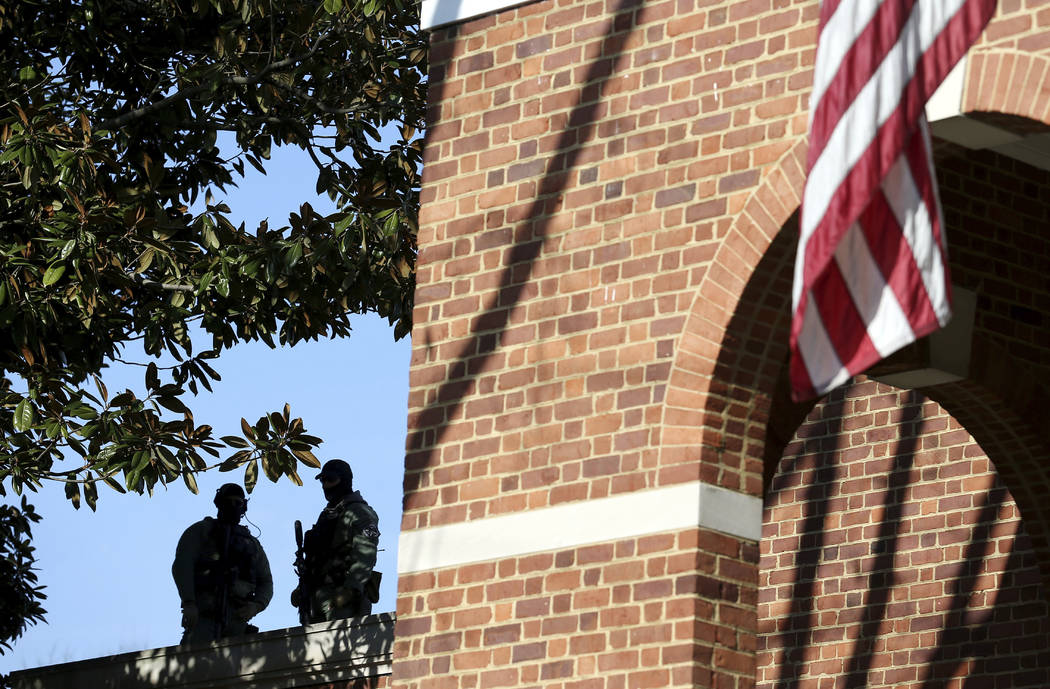 Police officers monitor the front of the Charlottesville Circuit Court building ahead of the preliminary hearing for James Fields on Thursday, Dec. 14, 2017 in Charlottesville, Va. Fields is accus ...