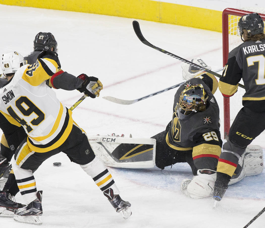 Golden Knights goaltender Marc-Andre Fleury (29) makes a save during the first period of Vegas' home matchup with the Pittsburgh Penguins on Thursday, Dec. 14, 2017, at T-Mobile Arena, in Las Vega ...
