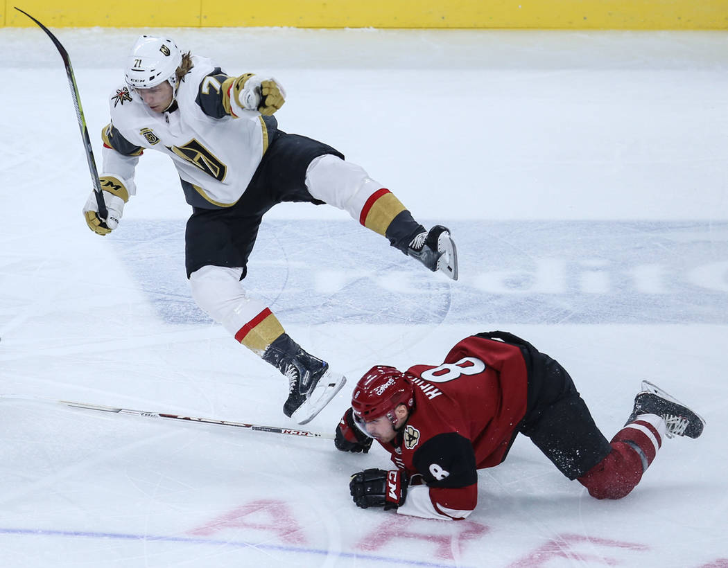Arizona Coyotes center Derek Stepan (21), left, Vegas Golden Knights center William Karlsson (71), center, and Arizona Coyotes right wing Tobias Rieder (8), right, chase after the puck during the  ...