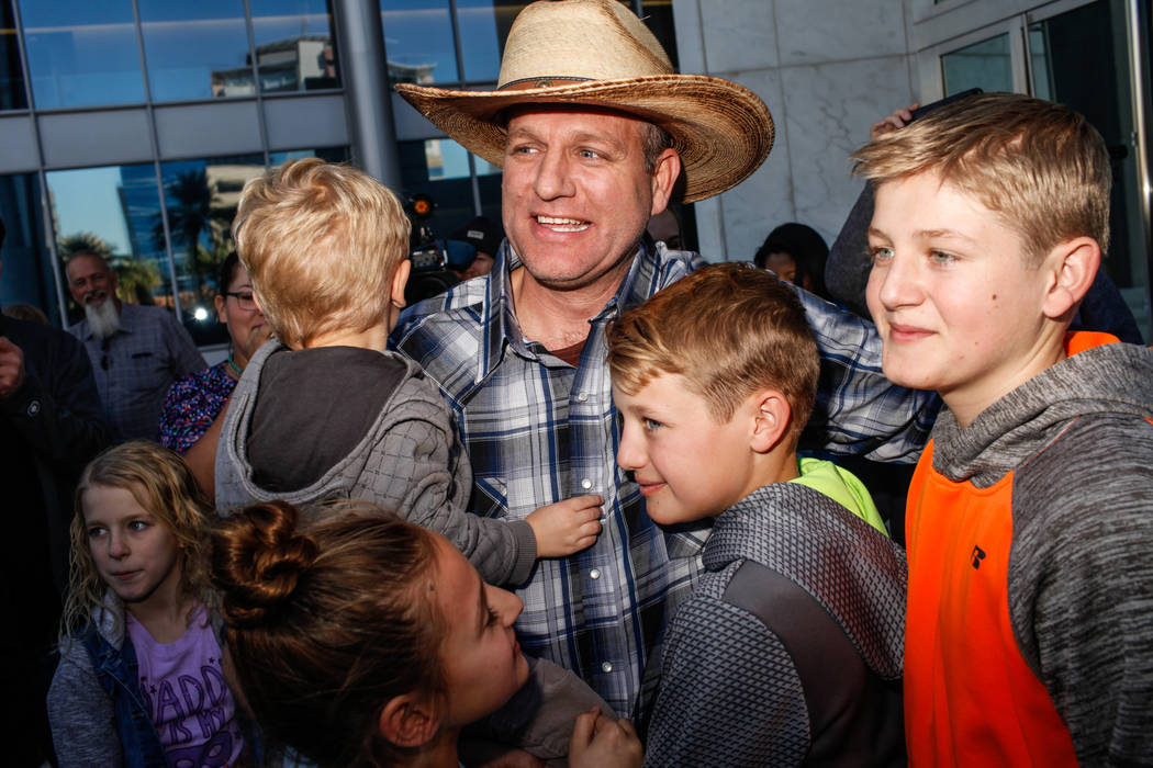 Ammon Bundy embraces his children outside the Lloyd George U.S. Courthouse in Las Vegas, Thursday, Nov. 30, 2017. Bundy was released from jail Thursday morning. Joel Angel Juarez Las Vegas Review- ...