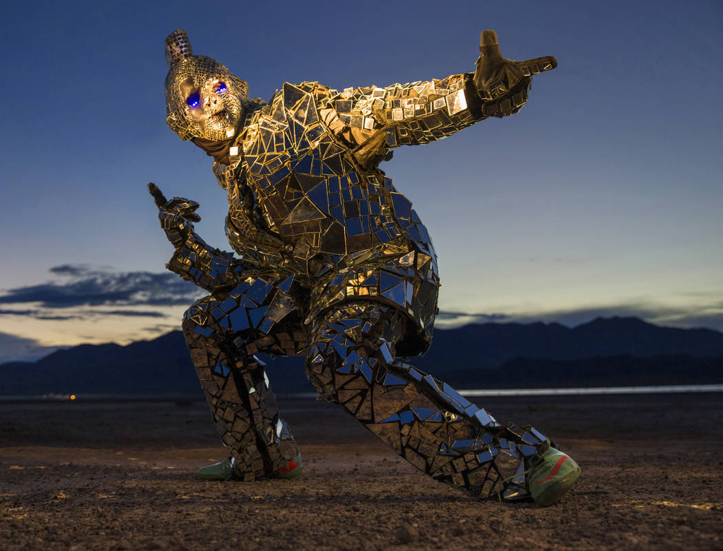 """Burner Steve MacWithey, aka """"Man in the Mirror,"""" hand made his famous glass suit containing over 5000 mirrored pieces. """"The suit allows people to see themselves and the  ..."""