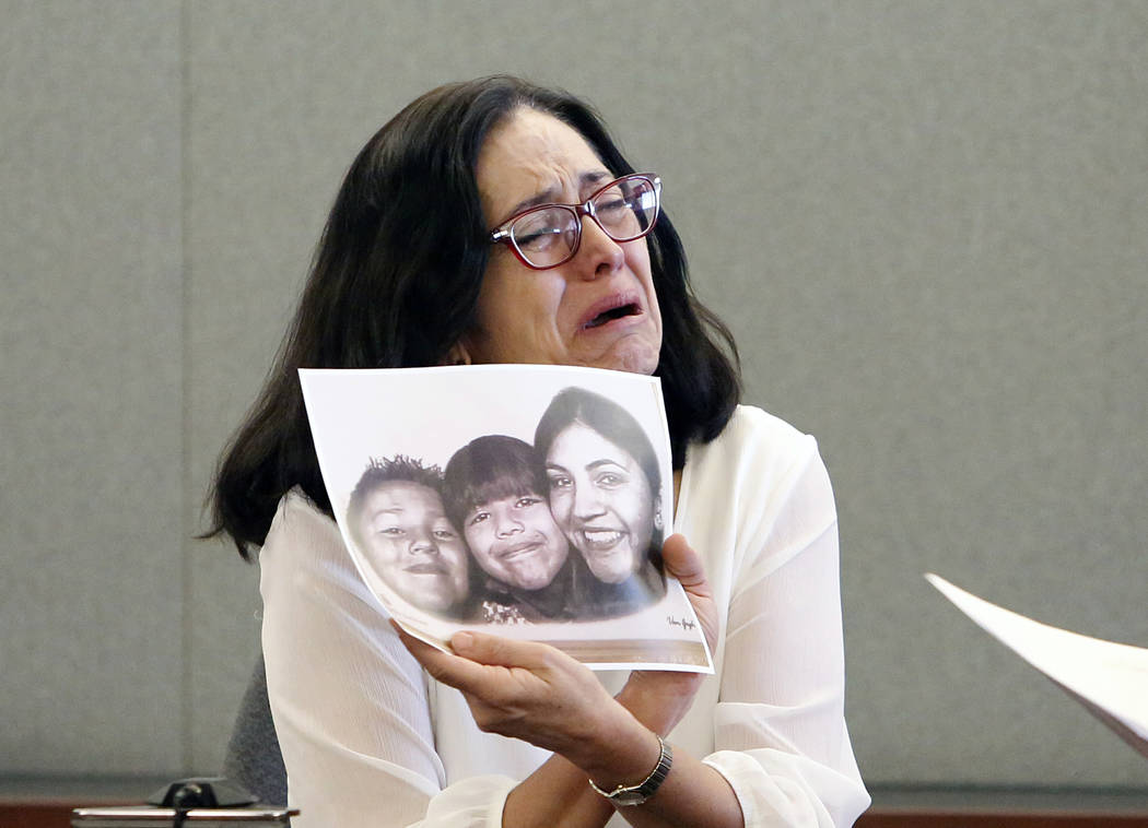 Martha Righetti, mother of Javier Righetti, gets emotional as she displays a picture of her children as she testifies during her son's penalty phase trial at the Regional Justice Center Tuesday, M ...