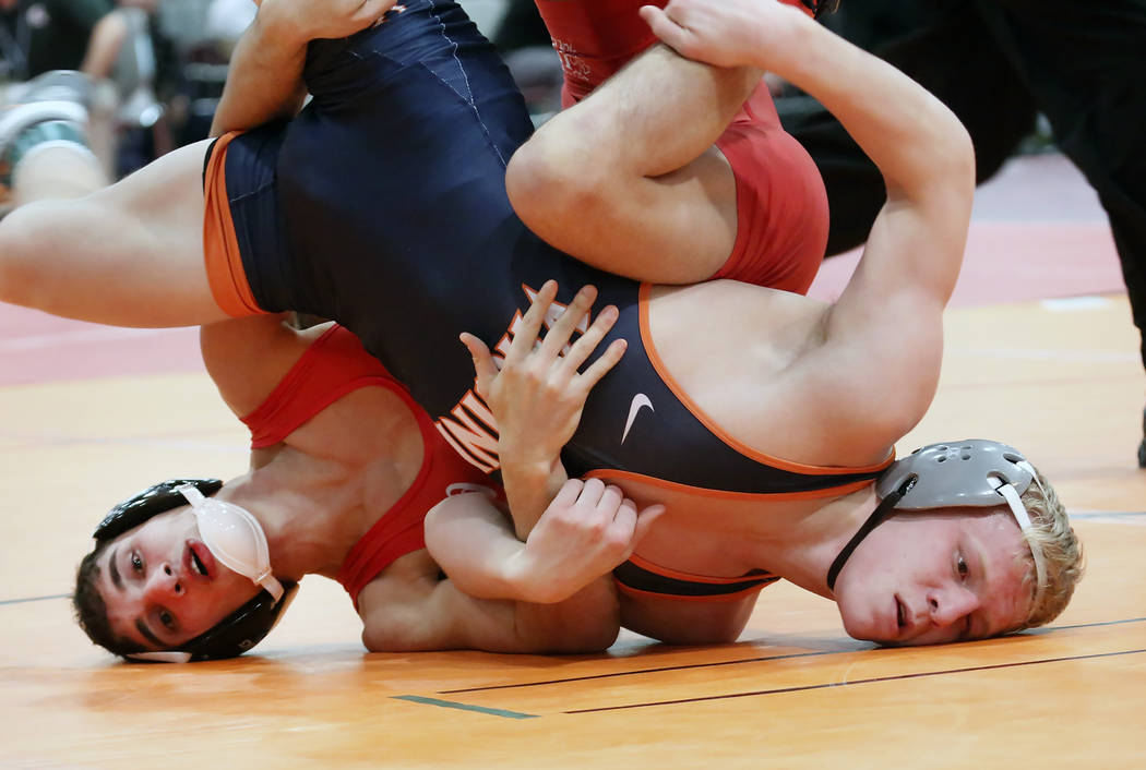 Cornell University's Michael Russo, left, and, Louie Hayes of Virginia wrestle during the 36th Annual Cliff Keen Las Vegas Collegiate Wrestling Invitational at the Las Vegas Convention Center Frid ...
