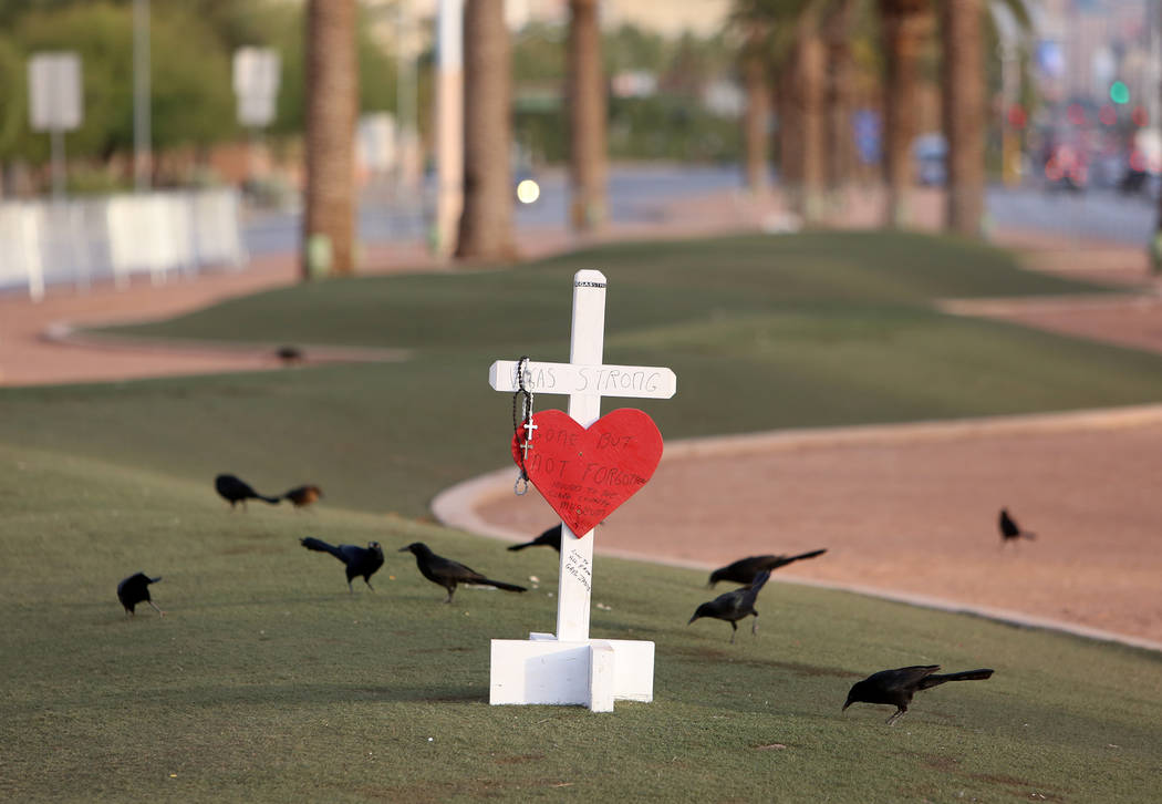 A white cross with Vegas Strong slogan at the Route 91 Harvest memorial site at the Welcome to Fabulous Las Vegas sign Monday, Oct. 13, 2017. Fifty eight crosses and items that were erected in hon ...