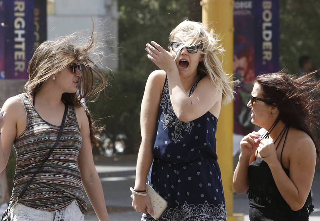 Pedestrians have their hair blown by wind as they walk along the Strip on Thursday, June 30, 2017, in Las Vegas. Bizuayehu Tesfaye Las Vegas Review-Journal @bizutesfaye