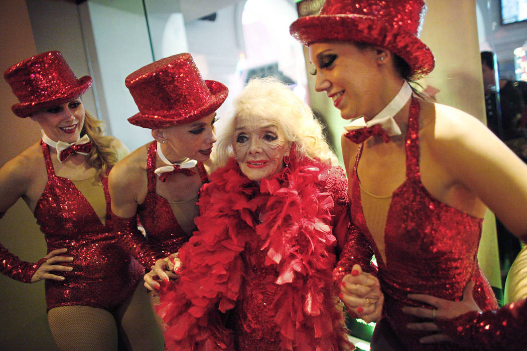 Former showgirl Gloria Mancilla, known as Gloria White, center, poses with Norma Wood, from left, Julie Langille, and Malory Huck, at her 90th birthday party at the Gold Diggers club at the Golden ...