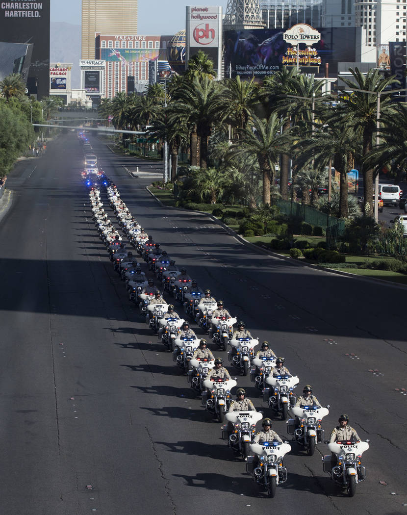 The funeral procession of Las Vegas police officer and Nevada National Guard veteran Charleston Hartfield, at the intersection of Tropicana Avenue and Las Vegas Boulevard in Las Vegas, Friday, Oct ...